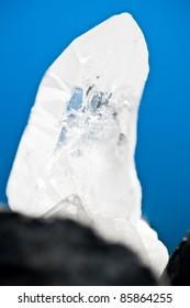 white shining rock mountain crystall quarz on blue ground