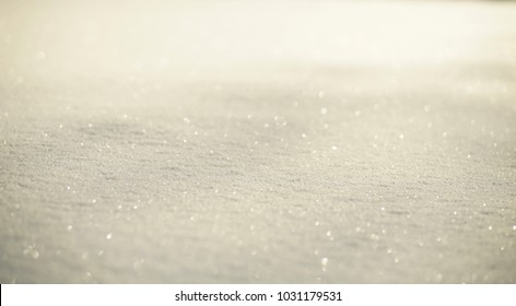 White shiny glowing snow background, snow texture on sun, closeup
