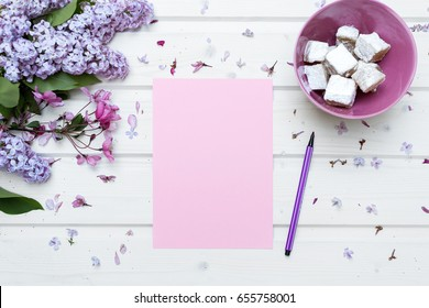 White ship deck tabletop with a blank pink paper