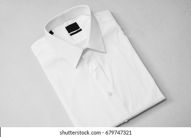 White shirt with blank tag on isolated background