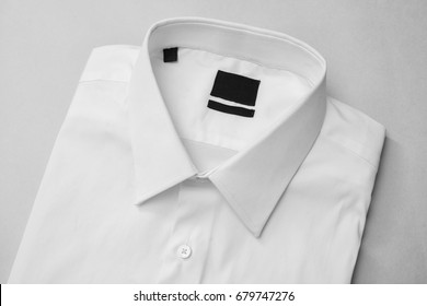 White shirt close-up with blank label, isolated