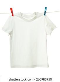 White shirt hanging on the clothesline. Image isolated on white background
