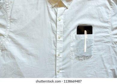 White shirt pocket with image of pen on smartphone