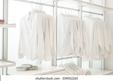 White shirts in built-in cupboard with other apparels