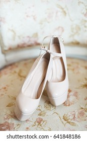 White shoes with platform stand on the chair