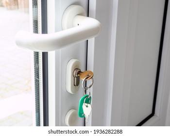 white shop door with key