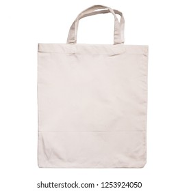 White shopping bag made of cotton fabric with handles isolated on white background
