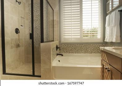 White shutters in bathroom window.