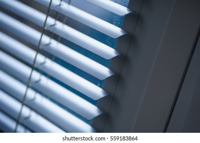 White shutters on the window in the Office