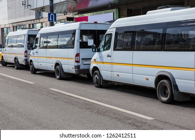 white Shuttle buses at the bus stop