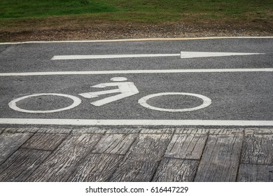 white sign bike land on concrete road.