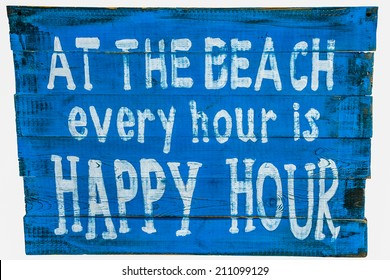 White sign on a wooden board of blue color: At the beach every hour is a happy hour. Isolated against white background