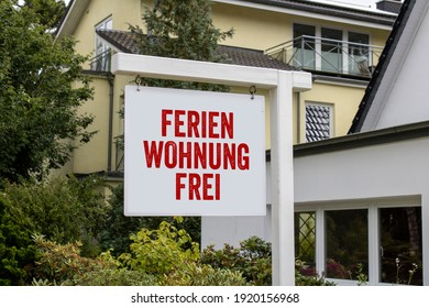 White sign with red letters and the german words for holiday appartment free - Ferienwohnung frei