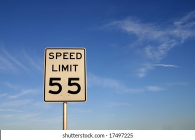 """White sign with """"speed limit 55"""" printed in black. Sign is shot against a blue sky. PHOTO ID: SpeedLimit5500016"""