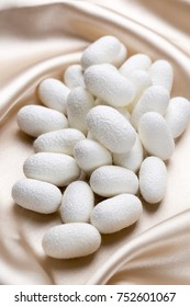 white silkworm cocoons shell. This is a source of silk thread and silk fabric