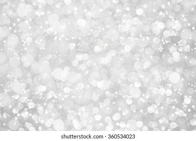 white silver glitter bokeh with stars abstract background