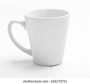 White simple elegant cup for tea without any pictures, original and lovely handle