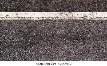 White single road line on asphalt texture