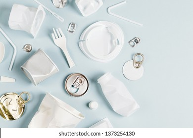 White single use plastic on  blue background. Concept of Recycling plastic.