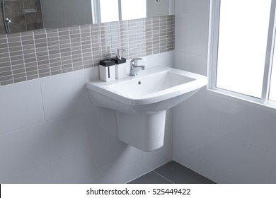 White sink and dispenser in bathroom