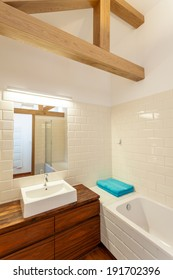 White sink on a wooden cupboard, vertical