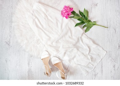 White skirt, shoes and peony. Fashionable concept.