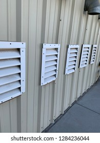 White slatted vents in side of laundry business building
