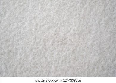 White sleet & snow on ground for background.