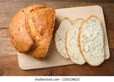 White sliced bread on cutting board on wooden background. Concept bread.
