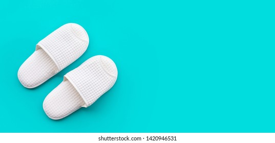 White slippers on color space  background.relaxation concepts ideas
