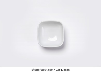 A white small bowl isolated white(grey) and top view.