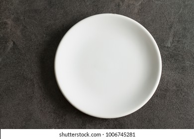 White small empty plate  on dark background