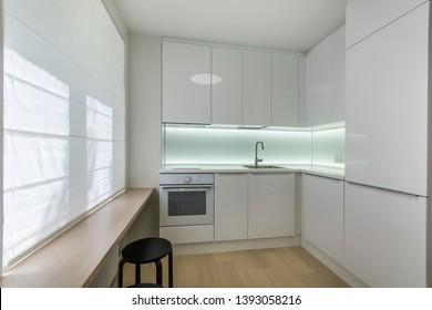 White small kitchen  in modern apartment