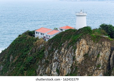 White small lighthouse. Hong Kong