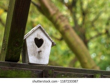 white small wooden birdhouse