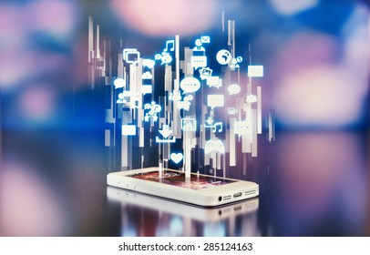 White smartphone emitting holograph with social media icons.