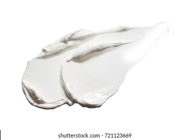 White smear of cosmetic cream isolated on white background. Creamy foundation texture isolated. Smear of face cream isolated. Texture of cream on white background