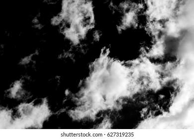 White smoke as a cloud on a black background