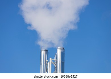 White smoke comes from the silver chimney.