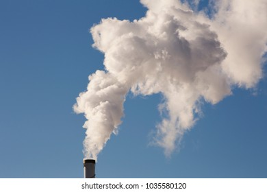 White smoke is coming out of the stack.