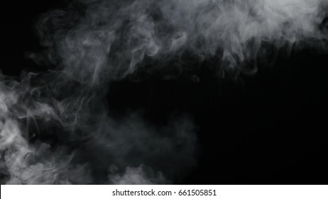 White Smoke floats over black background.