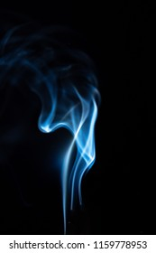 white smoke fragment isolated on black background.Smoke caused by smoke is white smoke, which is harmful to health.The concept of quitting smoking and maintaining health.