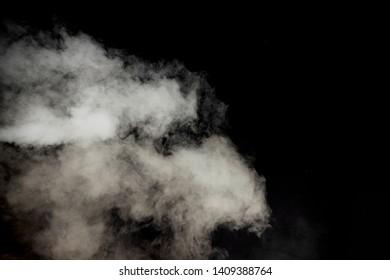 white smoke isolated on dark black background