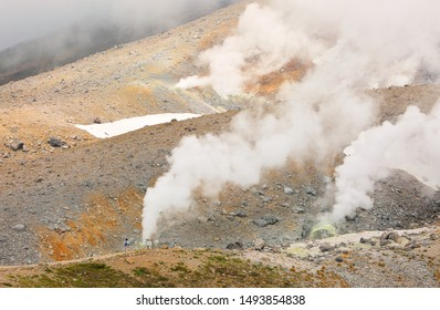 White smoke at Mount Asahi. Mount Asahi is a mountain located in the town of Higashikawa, Hokkaido and the tallest mountain in Hokkaido. It is part of the Daisetsuzan Volcanic Group.