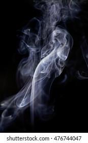 White smoke movement on black background.