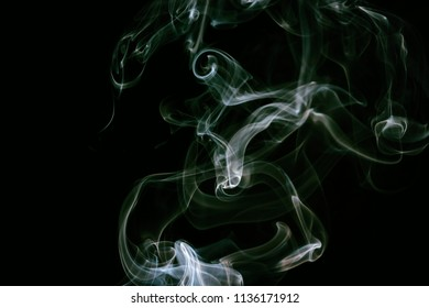 White smoke on black background and film filter