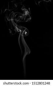 white smoke on dark background