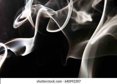 white smoke pattern on black background