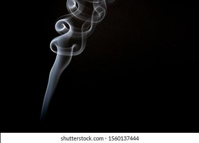 White smoke plume on a black background