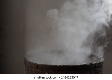 White smoke from steam glutinous rice in countryside kitchen. Soft picture